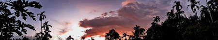 Beautiful photo of nature panorama, with sunset on the sky and clouds among forest natural area in countryside, Thailand.
