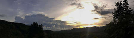 Beautiful photo of nature panorama, with sunset on the sky and clouds mountains forest natural area in countryside, Thailand.