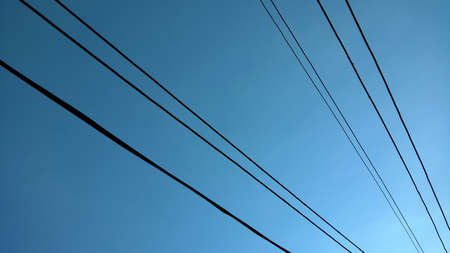 Blue Sky in countryside of Thailand, with selected focus sky image. There are electrical wire captured on blue sky background. Technology. Place for your text concept. Stock fotó - 157970325
