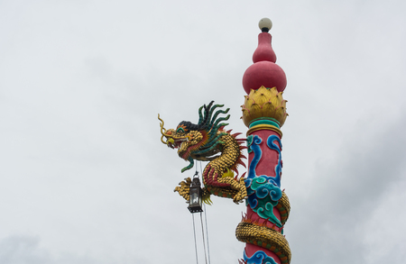 busts: Dragons on a pole at Samarn temple, Thailand Stock Photo