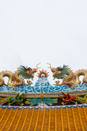 busts: Dragons on a roof at Samarn temple, Thailand