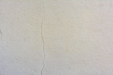 crack wall: A crack wall with vertical line Stock Photo