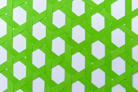 webbed: Green paper was weave with vertical pattern