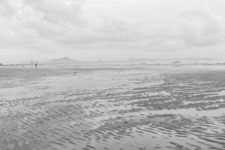 beach rain: Black and white beach before rain fall