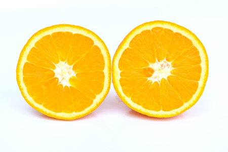two and a half: Two half sliced orange on white background