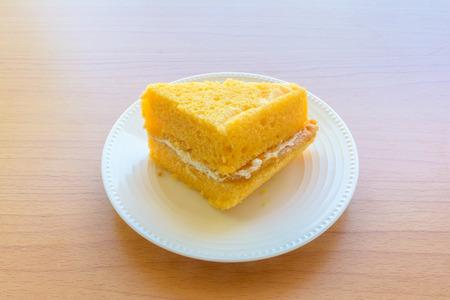 vanilla cake: Orange vanilla cake on wooden table