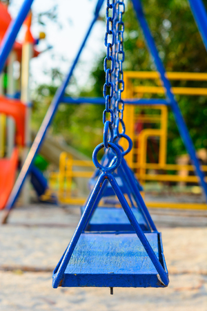 Playground in a park for children relax and fun Фото со стока