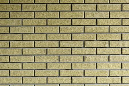 architect: Background. Brick wall of yellow. Brown.