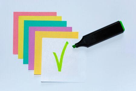 Grenn mark on white paper. Colored Leaflets for Recording.