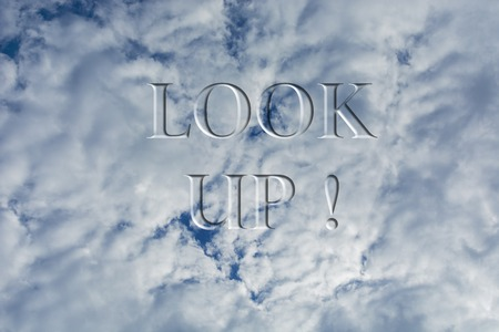 The sky with white clouds with the inscription Look up. Stock Photo