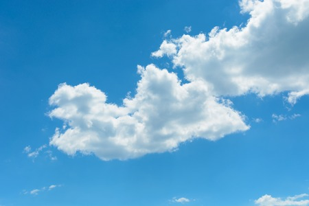 Two white clouds on the blue sky background.