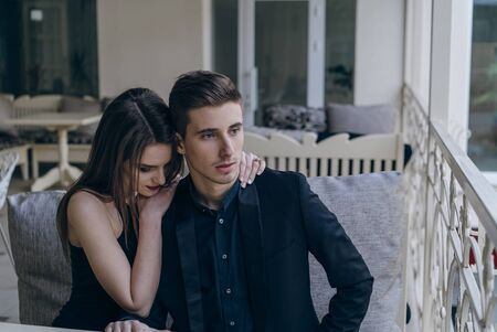 Young beautiful hipster couple vintage style posing outdoor on the street fashion style having fun together