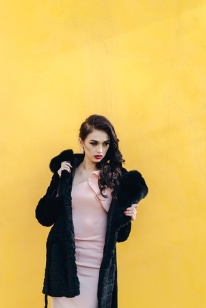 austere: Girl in winter clothes model looks. Posing for the camera Stock Photo