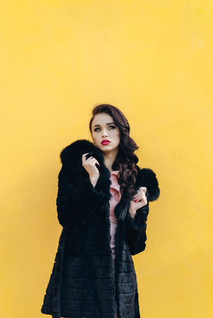 understated: Girl in winter clothes model looks. Posing for the camera Stock Photo
