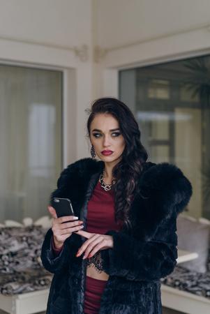 Portrait of a seductive lady in an elegant coat Reklamní fotografie
