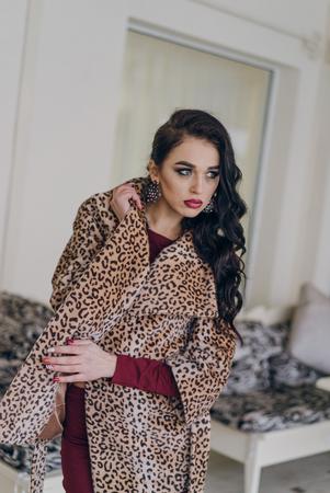 Beautiful smiling woman in tiger dress. Model