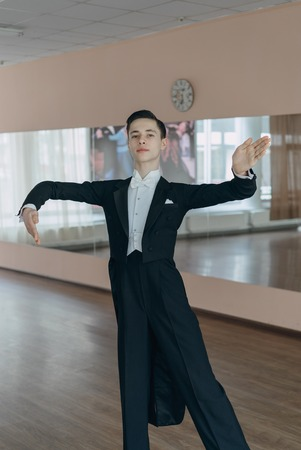 16s: Professional dancer trained at the mirror. The young boy