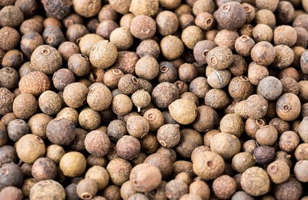 Photo Allspice pepper sweet peas closeup macro Stock Photo