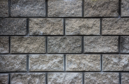 Gray wall of granite bricks texture background