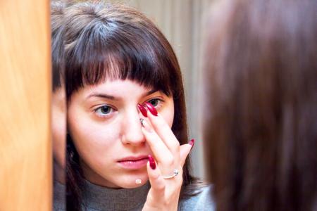 looking into: Girl looking into mirror