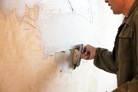 home repairs: Man plastering wall Stock Photo
