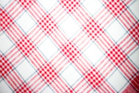 Blurred red checkered fabric Stock Photo
