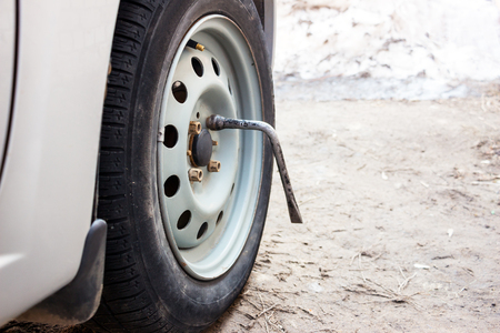 dirty car: Wheel brace. Selective focus. Unscrewing the wheel of the car 1 Stock Photo