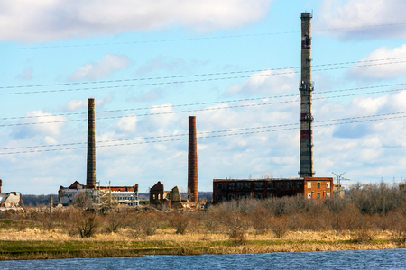 Old Abandoned chemical factory with chimneys on the banks of the river 1