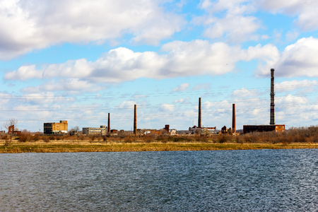Old Abandoned chemical factory with chimneys on the banks of the river 2