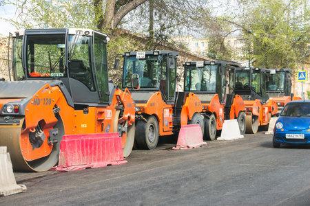 SAMARA, RUSSIA - MAY 14, 2017: A group asphalt compactors is located on Vilonovskaya Street in Samara. Heavy Vibration rollers compactors at asphalt pavement Editorial