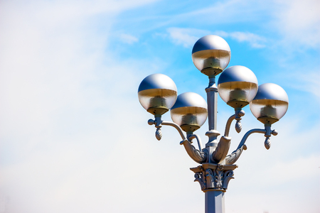 lamp light: Beautiful street lamp on a background of blue, little cloudy sky