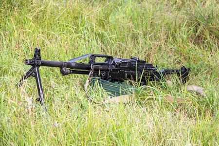 Machine gun Pecheneg. The Machinegun is in the grass. Served in the Russian Army