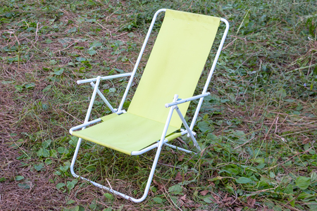 Folding chair - chaise lounge for relaxing in in camping Stock Photo