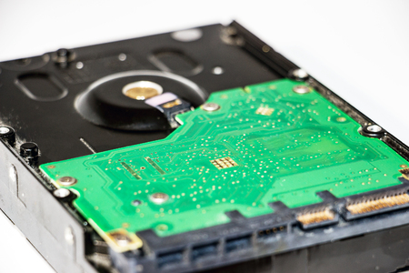 The back side of the hard drive. Internal part of the hdd. Selective focus Stock Photo