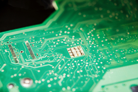 Parts of the computer. The electronic circuit Board of the computer. Circuit Board hard drive. Selective focus