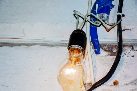 Bad electrical wiring. Dangerous connection with an incandescent lamp 写真素材