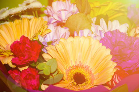 Bright beautiful bouquet of different flowers in sunlight