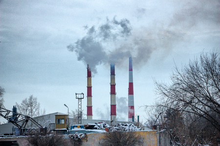 Smoking chimneys of the plant. Fuming chimney of a factory 写真素材