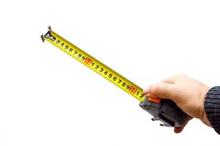 Measuring tool. Hand with a tape measure isolated on white background Archivio Fotografico