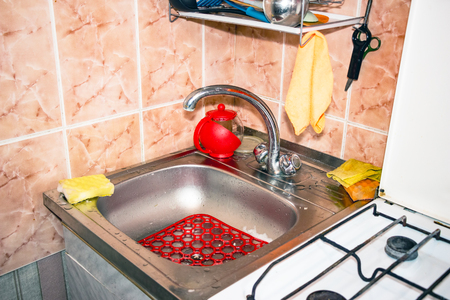 Sink with the faucet in the kitchen Stock Photo