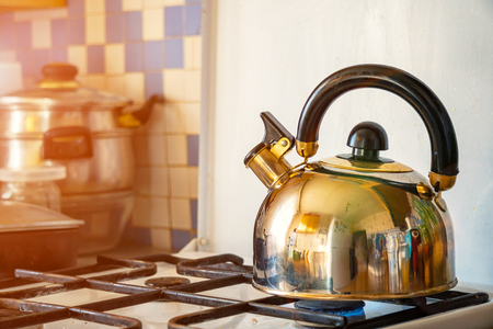 The whistling kettle on a gas stove