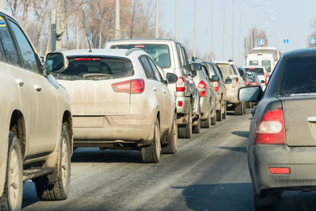 Cars standing in a traffic jam on a city street Stock Photo