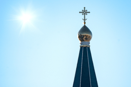 Orthodox cross on the dome of the Church against the clear blue sky Stock Photo