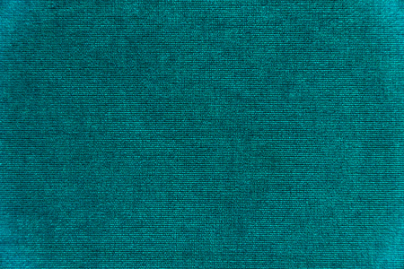 Dark green velvet texture background. Green velvet fabric Stock Photo