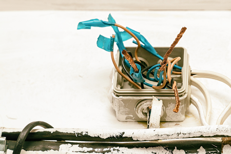 Hazard electrical wiring. Exposed wire in the electrical wiring in the wall