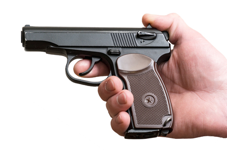 Gun in the hands of a man isolated on a white background Stock Photo