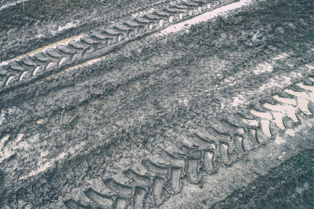 Imprint of an off-road vehicle tire on a dirty dirt road Stock Photo