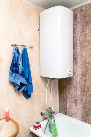 Home electric or gas water heater in the bathroom. Geyser