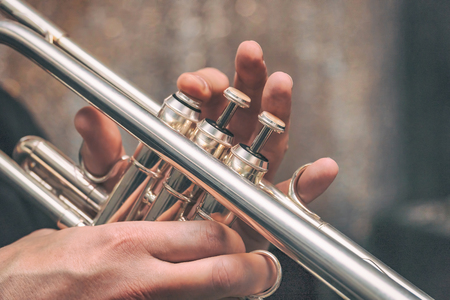 Hand of the Trumpeter on the buttons of the trumpet