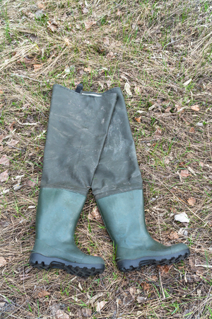 Boots for fishing on dry grass. Fishing Wellingtons